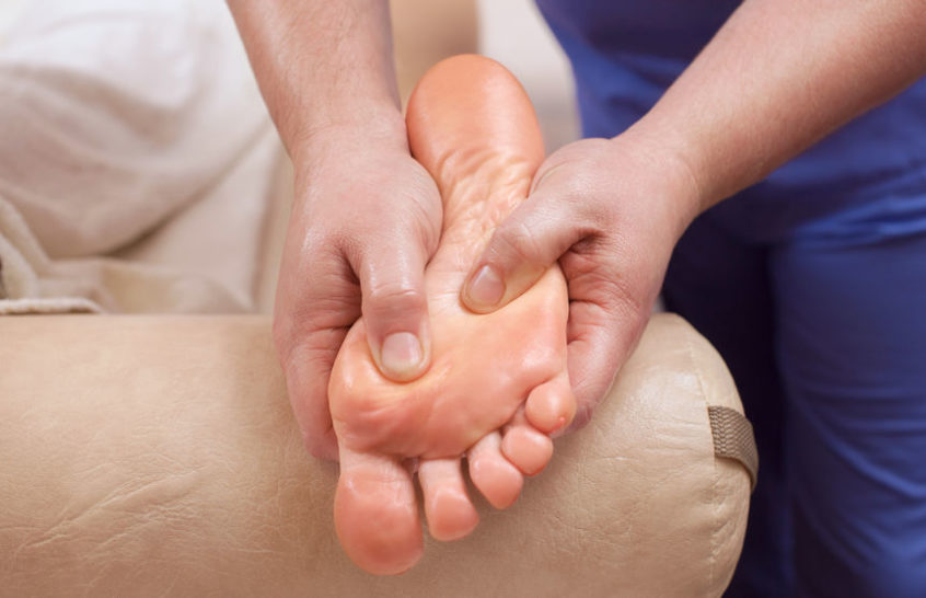 The doctor-podiatrist does an examination of the patient's foot